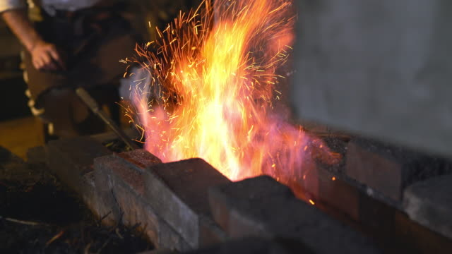 Blacksmith in his forge video