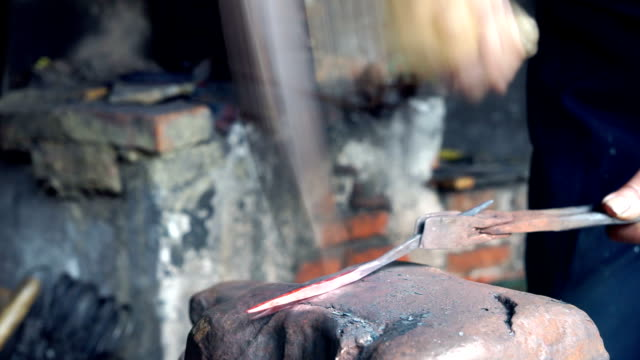 blacksmith is working in workshop video