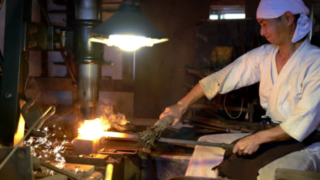 Blacksmith moulding hot metal block video