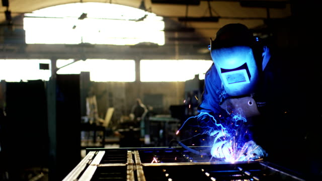 blacksmith or welder,with its grinding smooths steel and iron,in extreme slow motion,to make the surface smooth.The grinding wheel contact with the iron causes sparks.