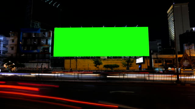 Blank advertising billboard, green screen, time lapse. Blank advertising billboard, green screen, beside road with traffic at night, for advertisement, time lapse. billboard stock videos & royalty-free footage
