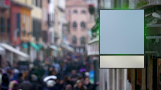 Blank billboard hanging in busy street video