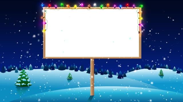 vídeos de stock e filmes b-roll de blank billboard on winter night with christmas lights - christmas card