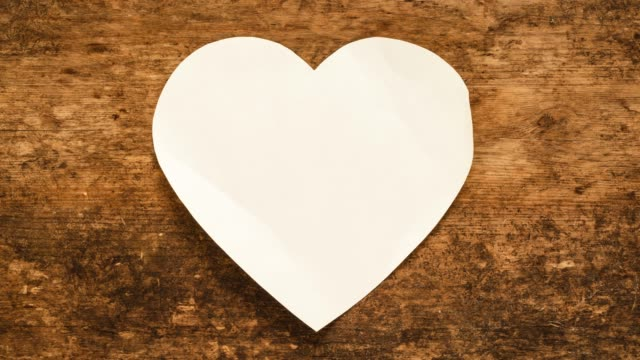 Blank Paper Background. Valentine note or message. Paper Heart. 4k Stop motion animation Video Clip - Seamless loop - Copy Space - Optimised for square video format. valentines day stock videos & royalty-free footage