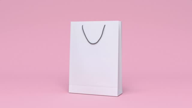 vídeos de stock e filmes b-roll de blank paper bag shopping mall business packaging environment concept minimal motion 3d rendering - tote bag
