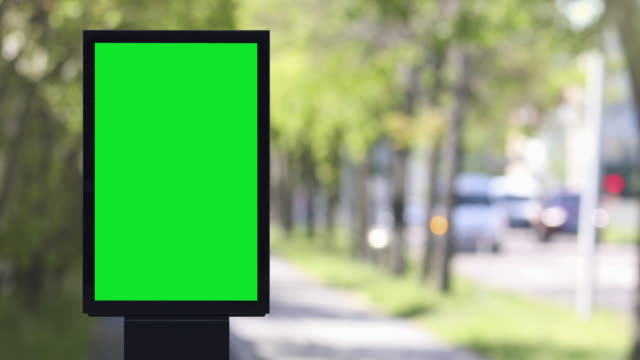 blank poster next to a city street - insegna commerciale video stock e b–roll