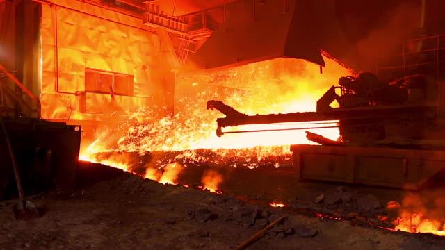 blast furnace splashing liquid metal molten iron in steel plant. - attrezzatura energetica video stock e b–roll