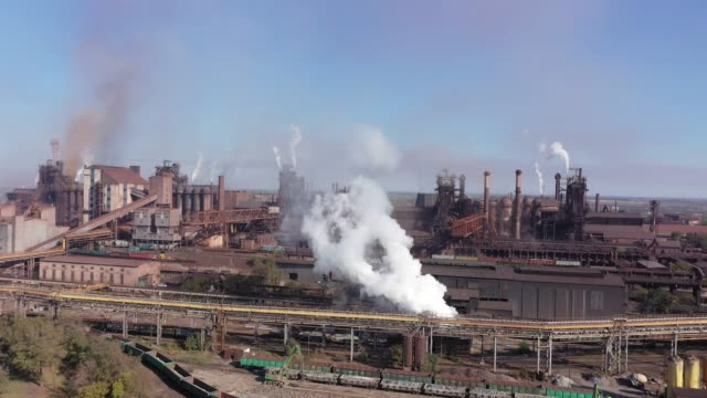 Blast furnaces aerial view. Blast furnaces aerial view. Metallurgical Plant. Environmental pollution. steel mill stock videos & royalty-free footage