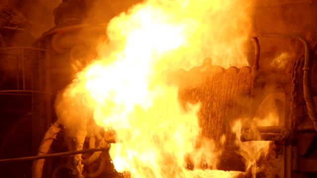 Blast furnance at a metallurgical plant, iron and steel works Working blast furnance at a metallurgical plant steel mill stock videos & royalty-free footage