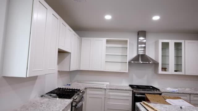 blind skåp island lådor och counter skåp installerade av vit färg - looking inside inside cabinet bildbanksvideor och videomaterial från bakom kulisserna