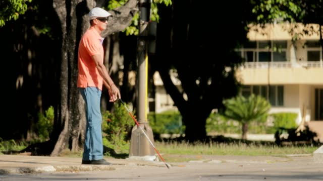 Blind Man Crossing The Street And Walking With Cane video