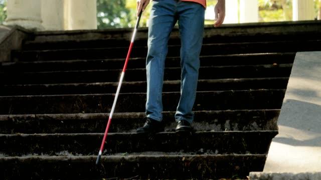 Blind Man Walking And Descending Steps In City Park video