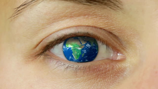 Blink globe   CO Extreme close up of a young woman's eye as she blinks to reveal a spinning globe of the earth which replaces her eyeball. Representing global communications and how the world has shrunk so much that we all worldwide knowledge & should be responsible for our environment. time zone stock videos & royalty-free footage