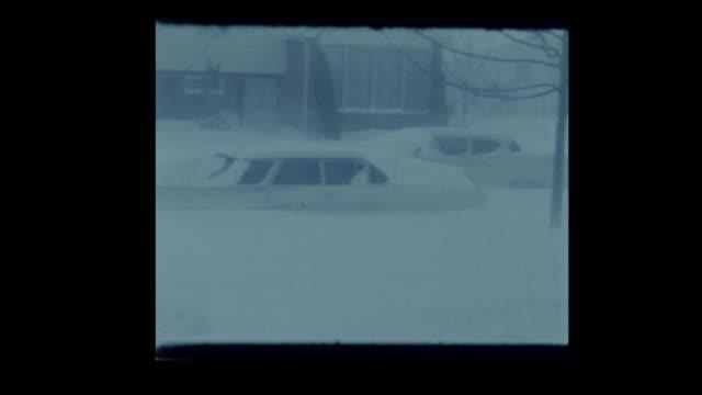1964 Blizzard blankets vintage cars in suburban neighborhood in deep snow