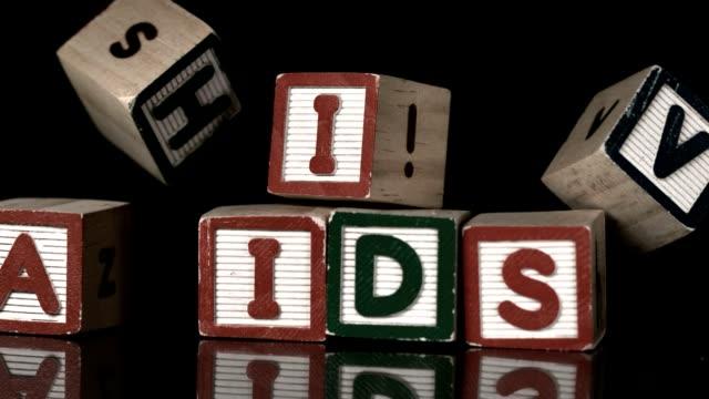 HIV blocks falling on AIDs video