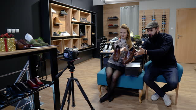 Bloggers holding shoes while recording new video