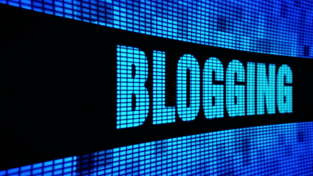 Blogging Side Text Scrolling LED Wall Pannel Display Sign Board Blogging Side  Text Scrolling on Light Blue Digital LED Display Board Pixel Light Screen Looped Animation 4K Background. Sign Board , Blinking Light, Pixel Monitor . LED Wall Pannel homepage stock videos & royalty-free footage