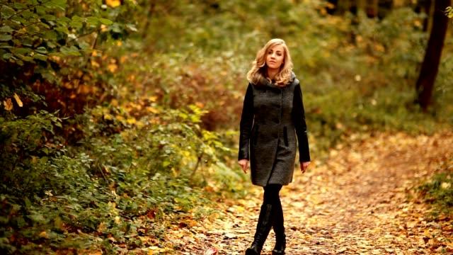 blond elegant woman walking in park video