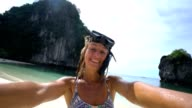 istock Blond girl on vacations taking selfie portrait 844068532