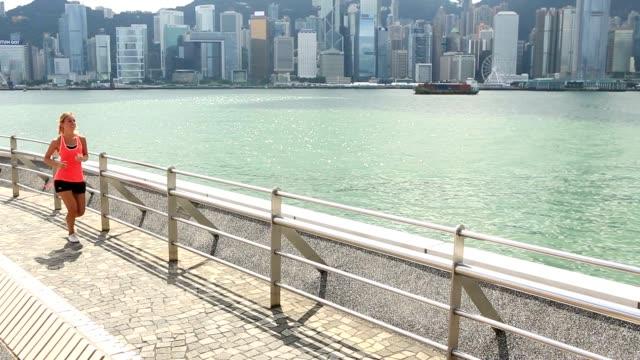 Blond girl running in Hong Kong video