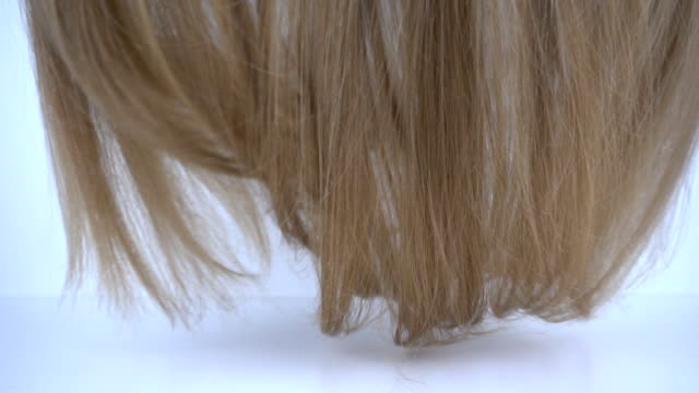 Blond hair falling in slow motion. Blond hair falling in slow motion. human hair stock videos & royalty-free footage