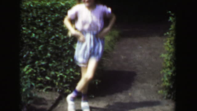 1949: Blond long braided hair light skinned girl dancing jig outdoor shorts. video