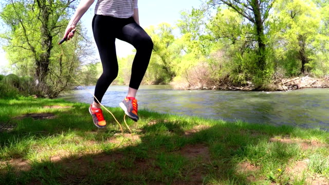 Blond woman training with jumping rope outside video