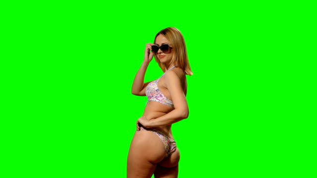 Blonde girl posing in a swimsuit (alpha channel) video