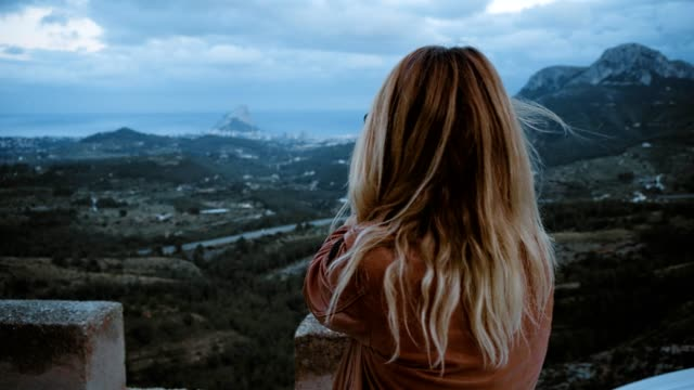Blonde girl travels in mountains video