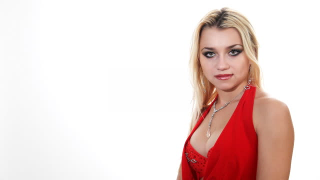 blonde in red dress on white background - cleavage stock videos & royalty-free footage