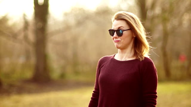Blonde in the background of a spring park. The girl is unhappy, her face has emotions of bewilderment, contempt and surprise. She wears sunglasses on her, her left eyebrow indignantly raised Blonde in the background of a spring park. The girl is unhappy, her face has emotions of bewilderment, contempt and surprise. She wears sunglasses on her, her left eyebrow indignantly raised. disgust stock videos & royalty-free footage