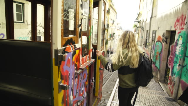 Blonde woman boarding a tram City life details of Lisbon, Portugal long hair stock videos & royalty-free footage