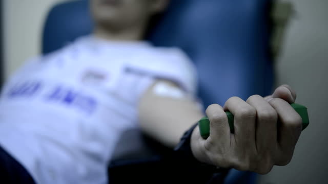 blood donor squeezes ball in his hand video