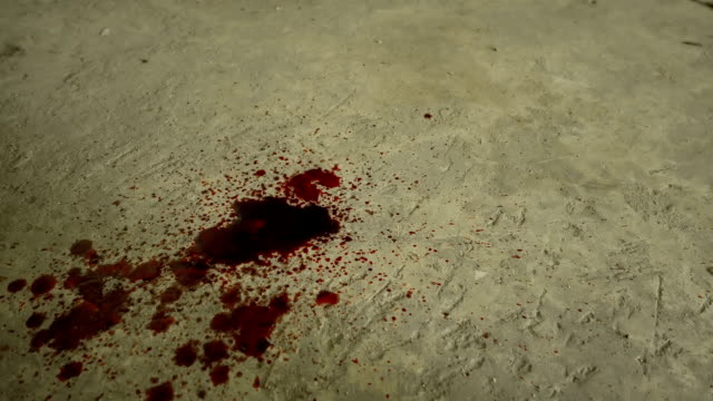 Blood dripping down into cement floor video