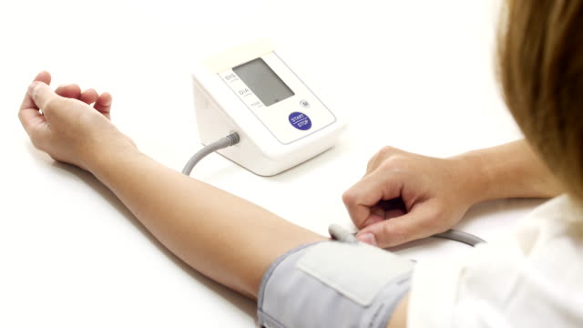 blood pressure check woman checking blood pressure with digital blood pressure gauge blood pressure gauge stock videos & royalty-free footage