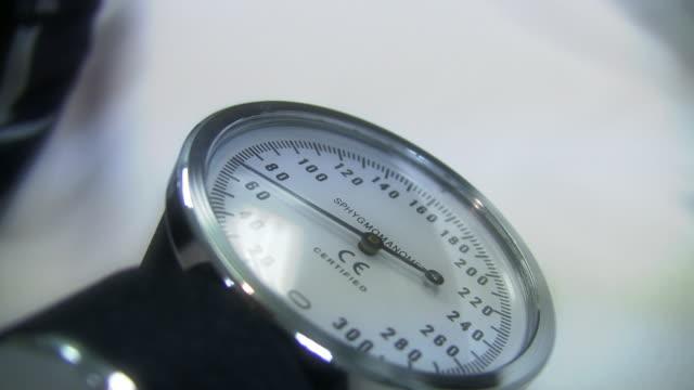 Blood Pressure Blood pressure needle rising.  blood pressure gauge stock videos & royalty-free footage