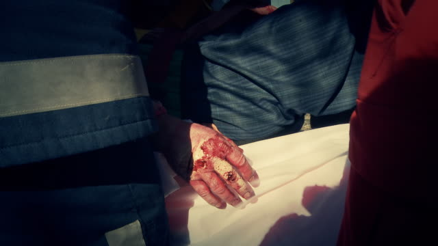 HD: Blooded Hand Of Injured Driver HD1080p: Close up shot of a blooded hand of an injured man from a crash accident. medevac stock videos & royalty-free footage