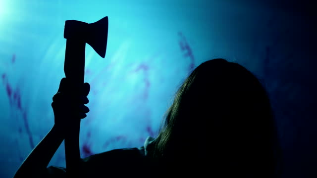 Bloody female butcher killing victim in darkness, manslaughter, nightmare video