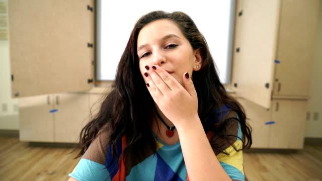 blowing kisses peace sign - blåsa en kyss bildbanksvideor och videomaterial från bakom kulisserna