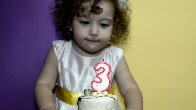 Blowing out candles, closeup video