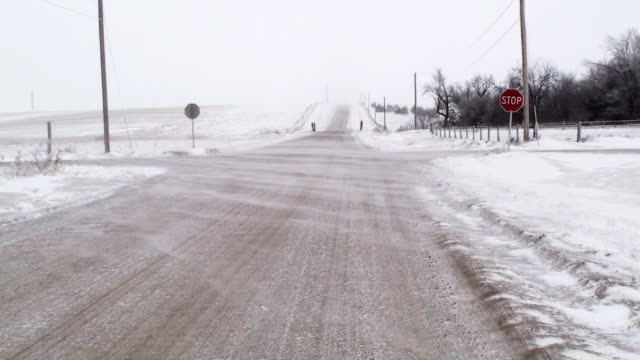 Blowing Snow Over Country Intersection video