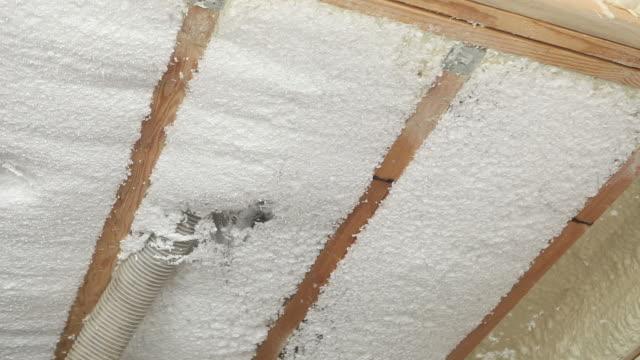 Blown Insulation being Installed between Floor Joists video