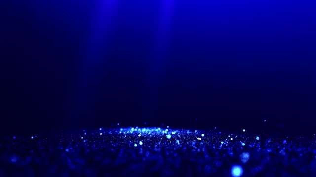 Blue abstract glittering particles with spotlights background video