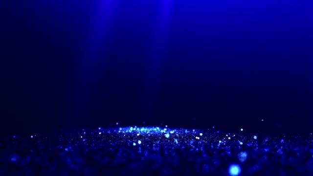 vídeos y material grabado en eventos de stock de partículas brillantes abstractas azules con focos de vídeo de fondo - celebration background