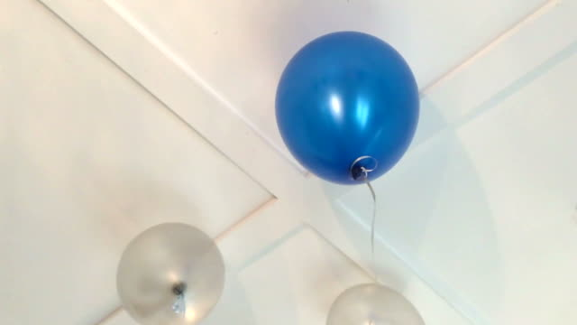 Blue and white party balloon on ceiling video