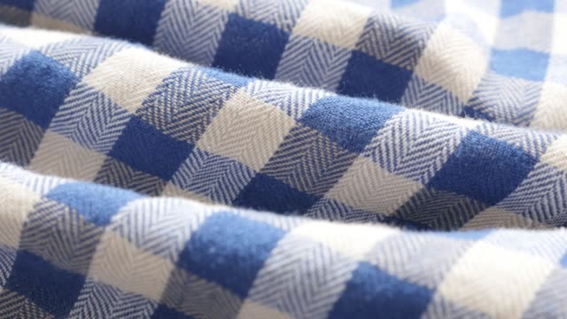 Blue and white shirt chequered pattern fabric texture slow tilt Blue and white shirt chequered pattern fabric texture slow tilt 4K 2160p 30fps UHD footage - Gigham check style clothing cotton fine material close-up plaid stock videos & royalty-free footage
