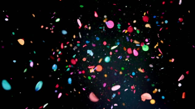 SLO MO LD Blue balloon popping and releasing glitter and confetti into the air