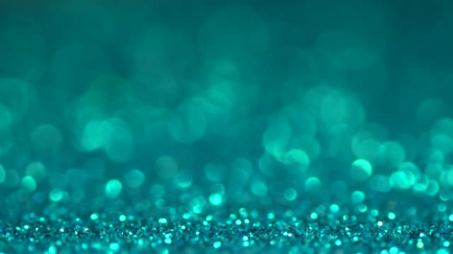 Blue brilliant shiny sparkly texture. Light bokeh effect abstract background