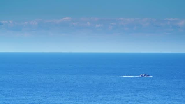 blue calm sea with little island, peloponnese - пелопоннес стоковые видео и кадры b-roll