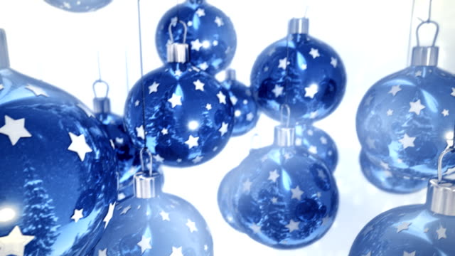 Blue Christmas balls on white background seamless loop video